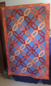 Cracker Blocks arranged in a 4 color woven pattern.