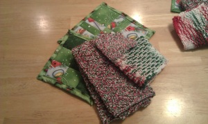 One set was 2 quilted Hot Pads, A knit dishtowel, dishcloth and scrubby